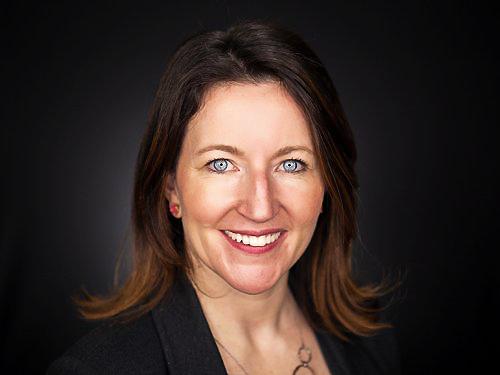 Headshot of Carolyn Magill